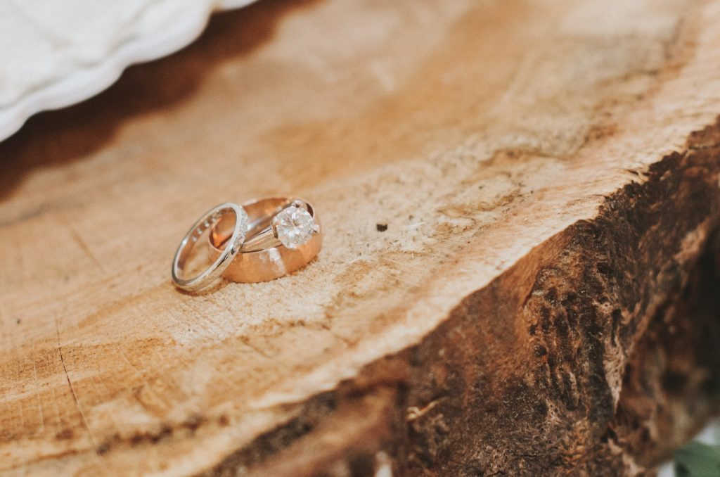 A close-up of the engagement ring and weddings bands of bride and groom Erin and Jesse Birden at their rustic wedding in Newtown, CT